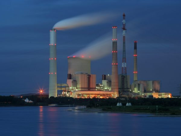 Coal-Fired power plant near Voerde, Germany. In front the  rhine river.